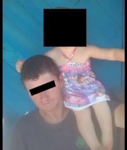 El despreciable sujeto junto a su pequeña hijita. (Misiones Online)