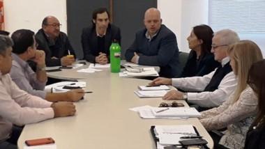 Debate. Pizzi y Arnaudo, de SEROS, se reunieron con las obras sociales privadas de Chubut.