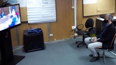 El ministro Puratich siguió por videoconferencia el encuentro virtual con la temática del coronavirus.