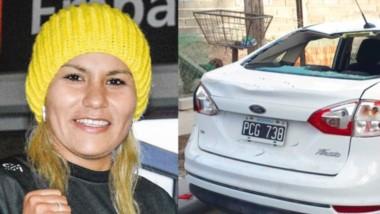 Liz Crespo, la denunciante del hecho, y el Ford Fiesta de la boxeadora que quedó con severos daños.