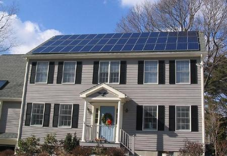 Solar panels on house roof winter view