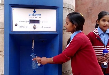 Girls getting water from atm
