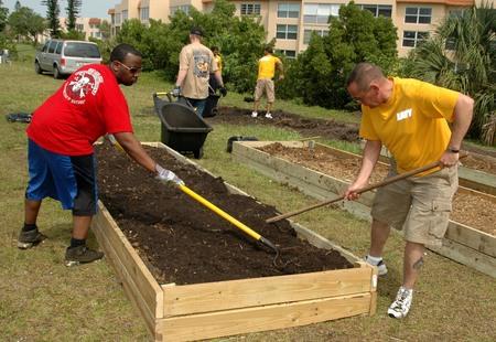 Us navy 100430 n 3237d 028 sailors rake dirt for a vegetable garden at victory living center during fleet week port everglades