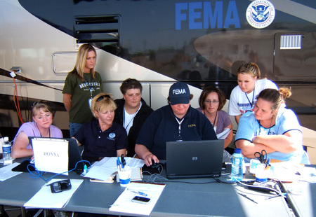 Fema   30523   new fema workers looking at a computer screen in kansas