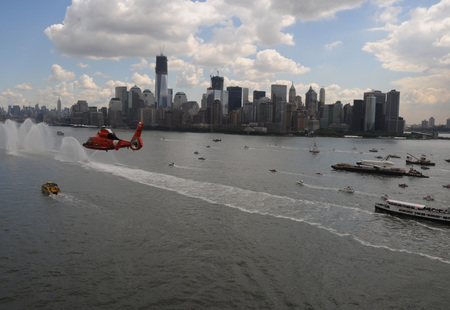 Coast guard flies above new york harbor during enterprise transport 120606 g nb914 017