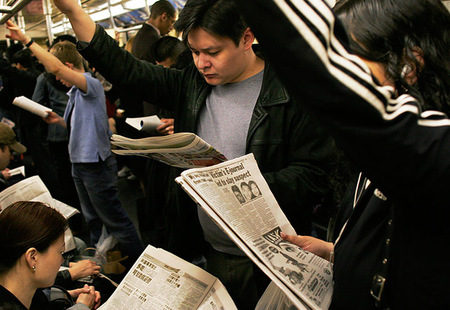Nyc subway riders with their newspapers
