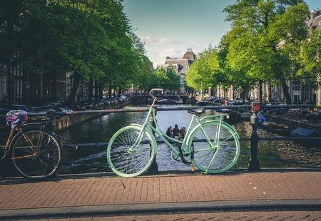 Town city bikes canal cobblestone bridge bicycles 924730