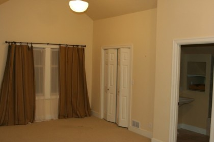 Master bedroom, with doors to closet and bathroom