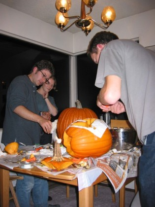 John flings pumpkin bits hither and thither