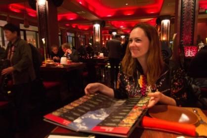 Perusing the menu at Lost Heaven