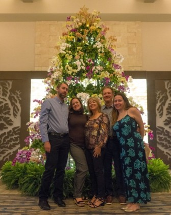 In front of the orchid tree