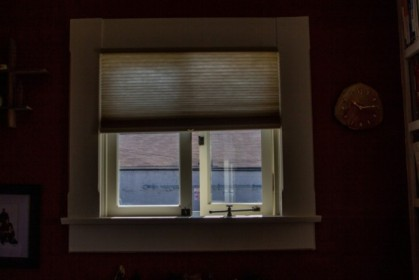 Small office window, old blinds
