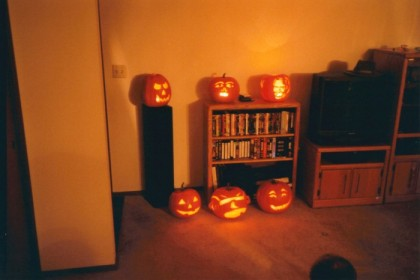 Pumpkins from the pumpkin carving party. Take special notice of the George W Bush pumpkin, top right