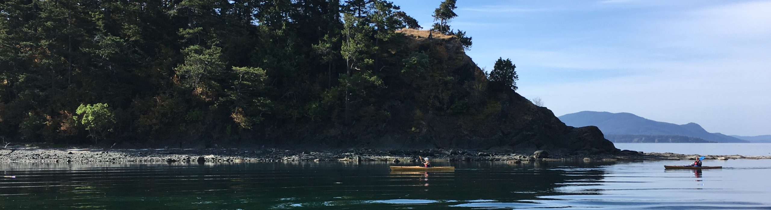 Kayakers paddle into Fox Cove on Sucia Island