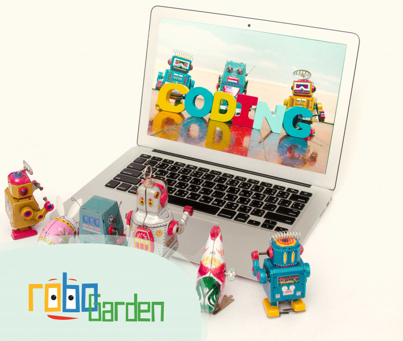 Small robots are standing around a laptop, which its screen shows a coding word.