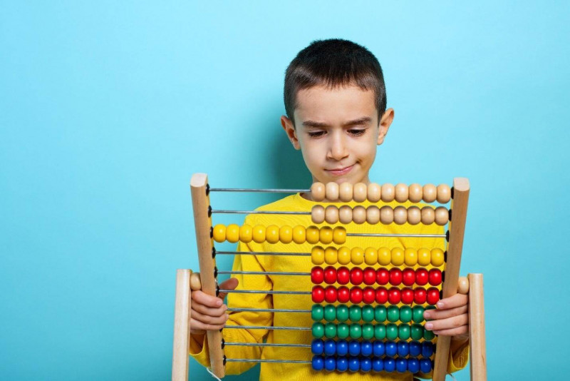 image shows that child looking for a solution to solve the puzzle.