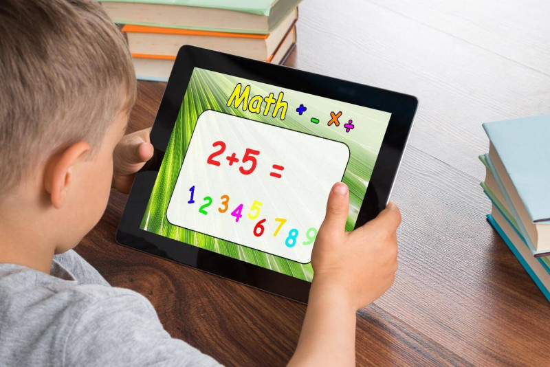 this image shows child learnig math on iPad