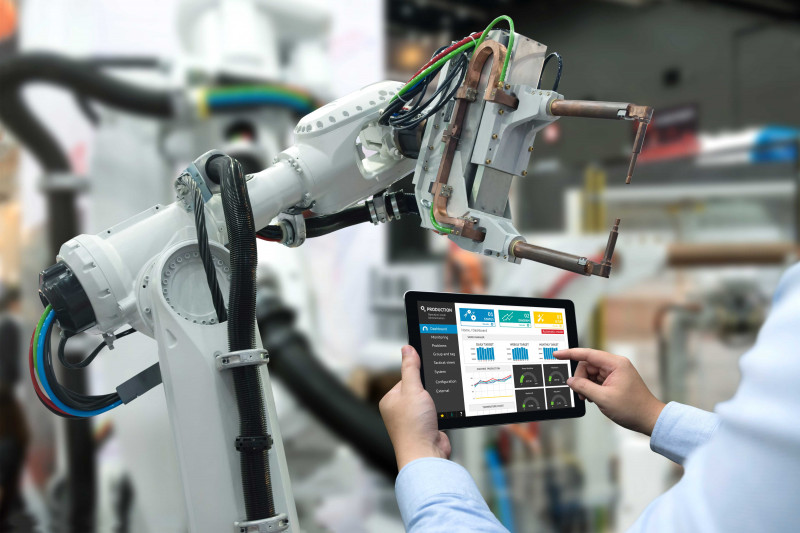 Image showing a technician working with robots