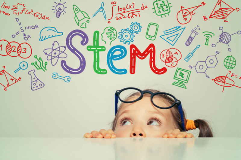 Image showing a girl who looks at a word of STEM