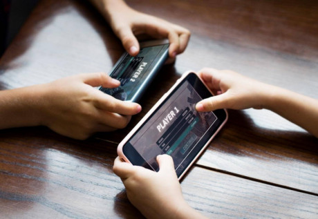 image shows playing video game on mobile.