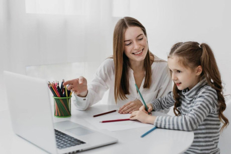 Image shows that mother supports her kid in coding education
