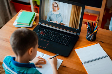 image shows that child is learning online