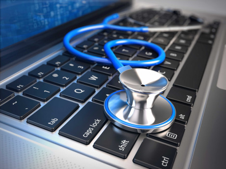 Image showing a stethoscope on a laptop as a symbol for programming
