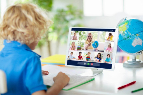 image shows kid is learning and talking online