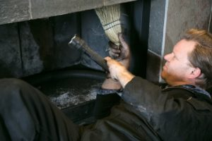 Chimney Inspection. Cleaning fireplace inside of home