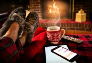 Picture of person's feet by fireplace.