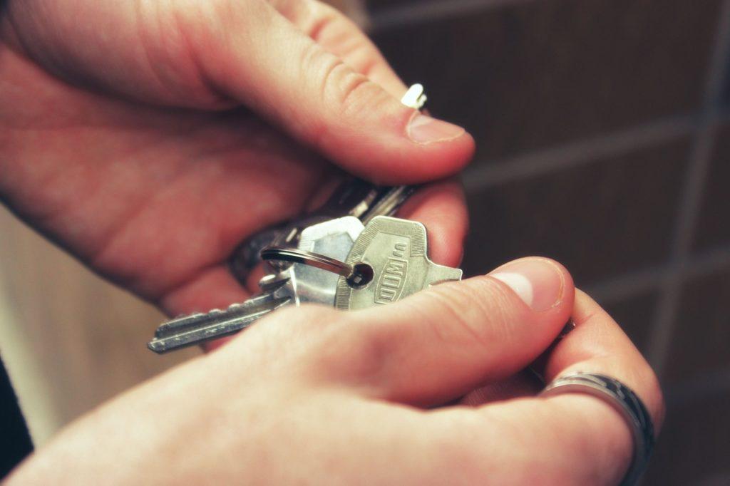 House keys held in hands.
