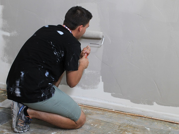 Male tenant painting a wall.