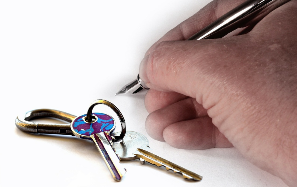 Keys next to hand writing with a pen