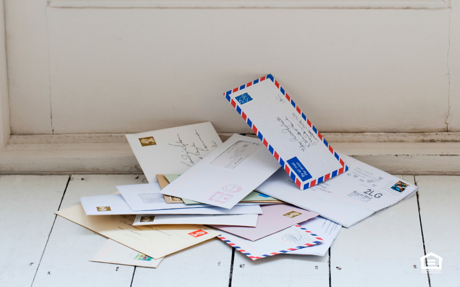 Pile of mail near inside of a door