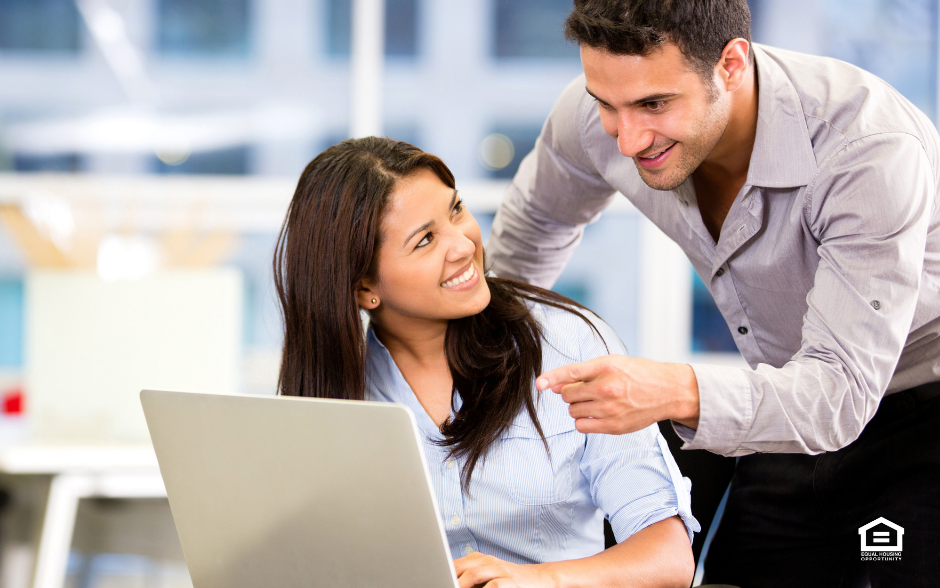 Man and woman with laptop computer