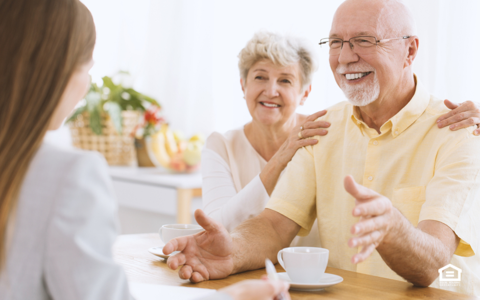 Elderly couple in business meeting