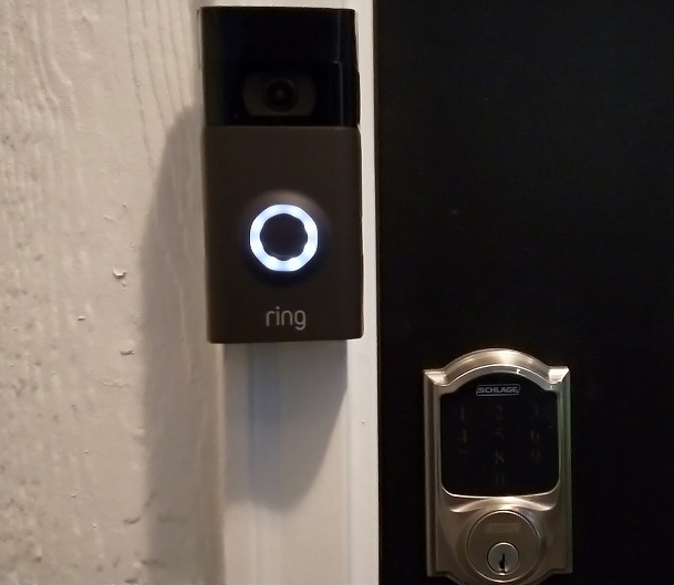 Ring smart doorbell mounted by door