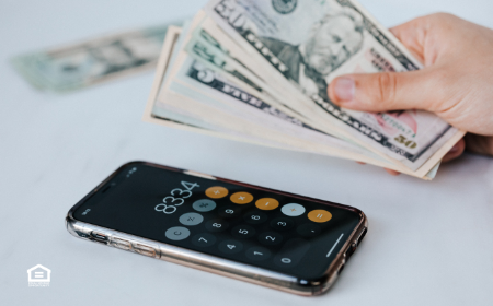 Calculating cash flow with cash in hand and smartphone calculator