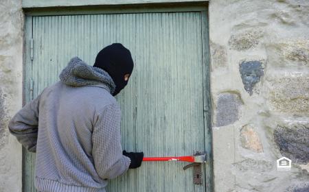 Squatter trying to pry open door.