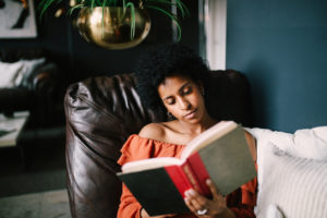 Woman Relaxing in Her Merced Reading Nook
