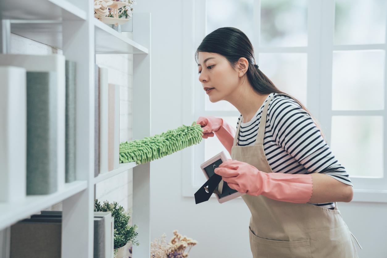 Jenks Woman Dusting a Shelf
