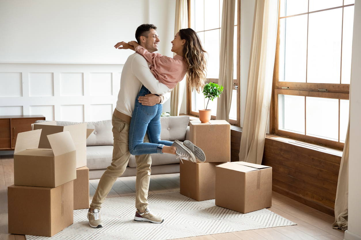 Happy couple moving to an apartment in Miami
