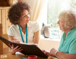 Alpharetta Landlord Explaining the Lease to an Elderly Tenant