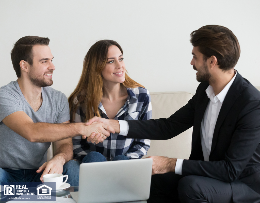 Alpharetta Renters Shaking Hands with a Property Manager