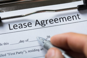 Signing a Lease Agreement for a Rural Hall Rental Property