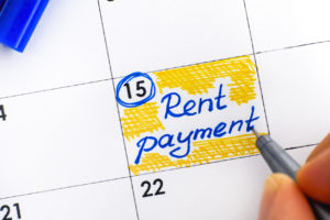 Marking the Calendar with a Reminder to Pay the Rent