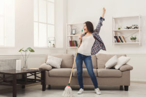 Acton Woman Tidying the Living Room