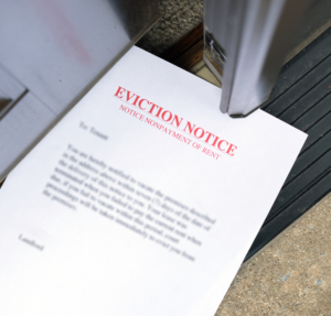 Eviction Notice Slipped Under an Open Door