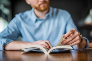 Burbank Real Estate Investor Reading an Informative Book