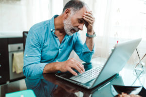 Frustrated Mature Man Working on Computer
